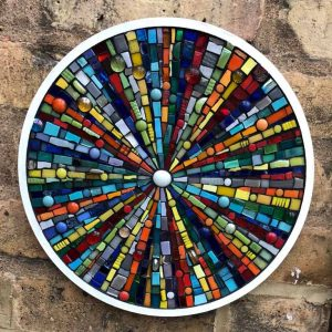 Coloured circle is a hand-crafted mosaic by Dorset artist Kitty Hartnell.