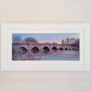 Julian's Bridge is a painting of a bridge at sunrise in Wimborne by Linda Courtney.