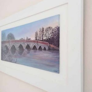 Side view of Julian's Bridge is a painting of a bridge at sunrise in Wimborne by Linda Courtney.