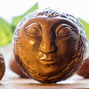 Goddess and Green man hand carved orb made by Yvonne Sturgeon.