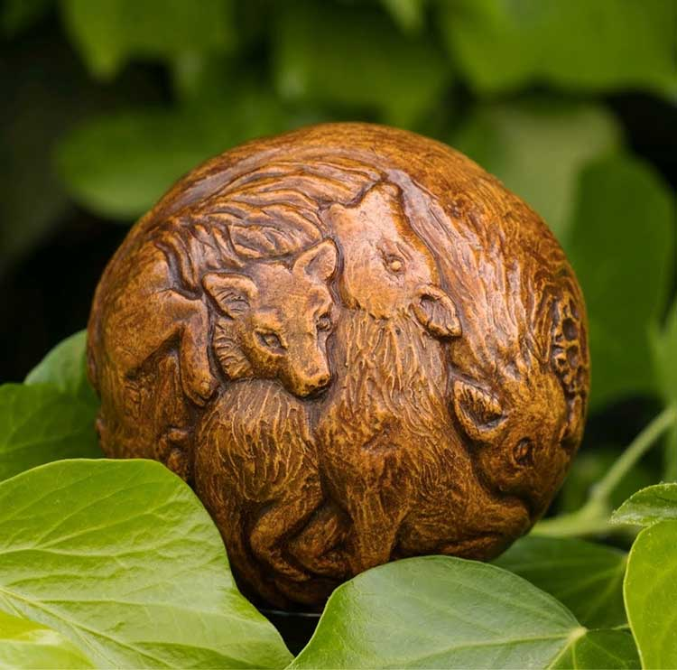 A hand carved wolf gesso totem orb made by Yvonne Sturgeon.
